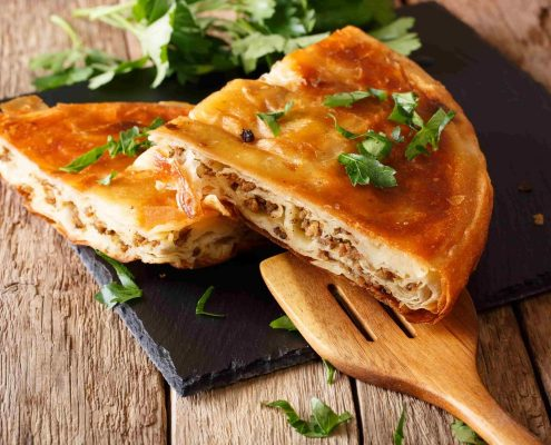 Delicious-appetizer-Balkan-burek-with-minced-meat-close-up-min